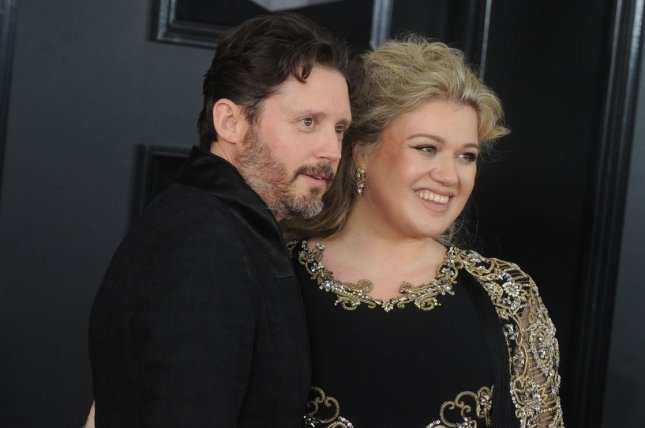 Kelly Clarkson (R) was ordered to pay her estranged husband, Brandon Blackstock, nearly $200,000 in spousal and child support in their divorce. File Photo by Dennis Van Tine/UPI