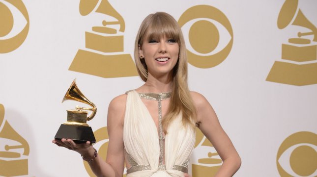 Taylor Swift appears backstage with the Grammy she won at the 55th Grammy Awards at the Staples Center in Los Angeles on February 10, 2013. UPI/Phil McCarten