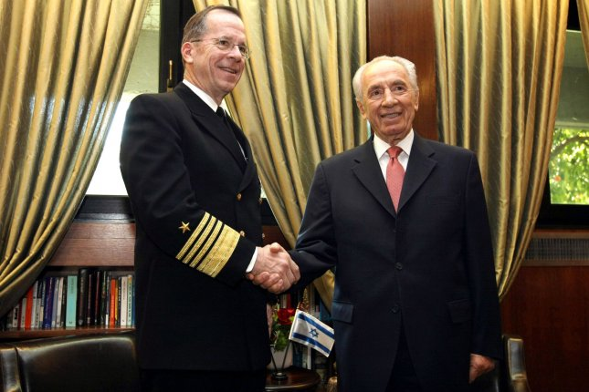 Israeli President Shimon Peres shakes hands with U.S. Navy Adm. Mike Mullen, chairman of the Joint Chiefs of Staff, as they meet at the president's residence in Jerusalem on February 14, 2011. UPI/Kobi Gideon/POOL