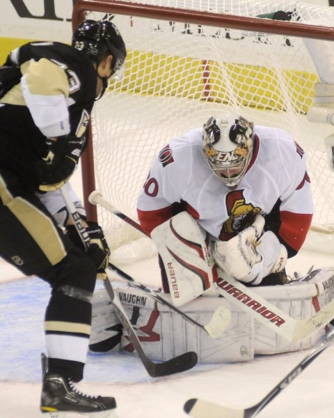 Ottawa Senators goalie Brian Elliott covers the puck following Pittsburgh Penguins left wing Alexei Ponikarovsky shot on goal in the second period of game one of the NHL Eastern Conference Quarter Final at Mellon Arena in Pittsburgh on April 14, 2010. UPI/Archie Carpenter