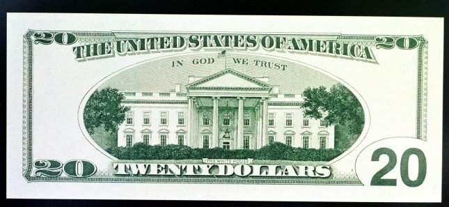 The phrase In God We Trust is seen on the back of a Twenty Dollar bill. File/UPI ms/HO