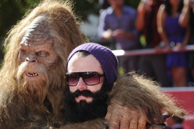 Sasquatch poses for pictures with MLB player Brian Wilson of the San Francisco Giants. (File/UPI/Phil McCarten)