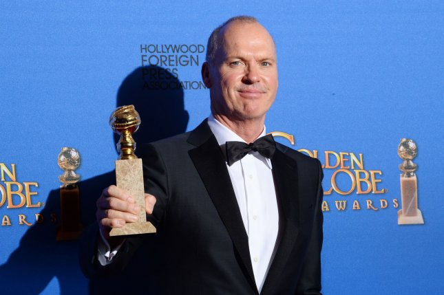 Michael Keaton appears backstage with the award he won for his role in Birdman during the 72nd annual Golden Globe Awards at the Beverly Hilton Hotel in Beverly Hills, California on January 11, 2015. Photo by Jim Ruymen/UPI