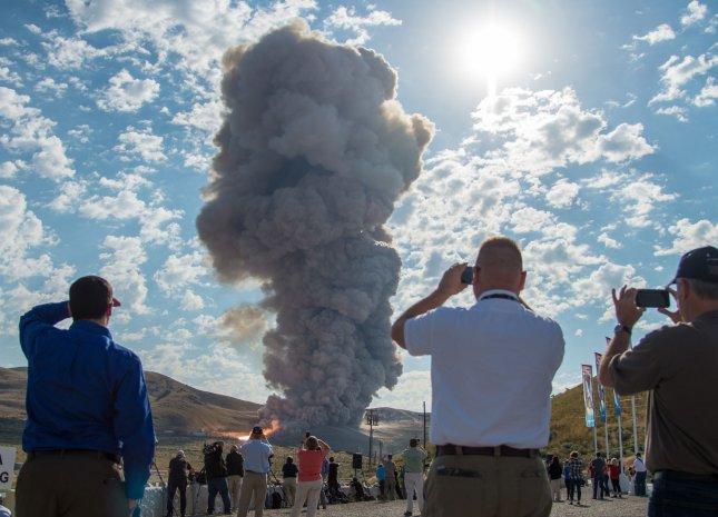 Guests watch the second and final qualification motor (QM-2) test for the Space Launch System's booster, Tuesday at Orbital ATK Propulsion Systems test facilities in Promontory, Utah. During the Space Launch System flight the boosters will provide more than 75 percent of the thrust needed to escape the gravitational pull of the Earth, the first step on NASA's Journey to Mars. NASA Photo by Bill Ingalls/UPI