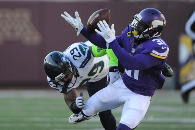 Seattle Seahawks free safety Earl Thomas (29) breaks up a pass to Minnesota Vikings running back Jerick McKinnon (31) in the first quarter of their AFC Wild Card game at U.S. Bank Stadium in Minneapolis on January 10, 2016. Photo by Marilyn Indahl/UPI