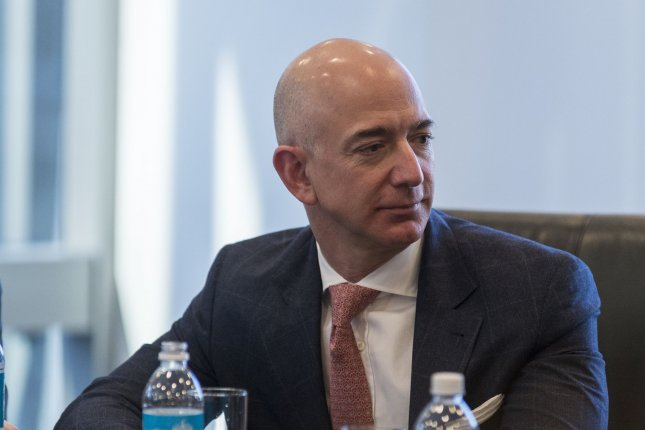 Amazon CEO Jeff Bezos attends a meeting of technology leaders with President-elect Donald Trump in New York in December. Amazon announced Thursday it plans to hire 100,000 additional workers in the next 18 months. Pool Photo by Albin Lohr-Jones/Pool