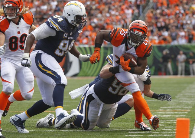 San Diego Chargers lineman Corey Liuget (94) attempts to make a play during a game against the Cincinnati Bengals. Photo by John Sommers II/UPI
