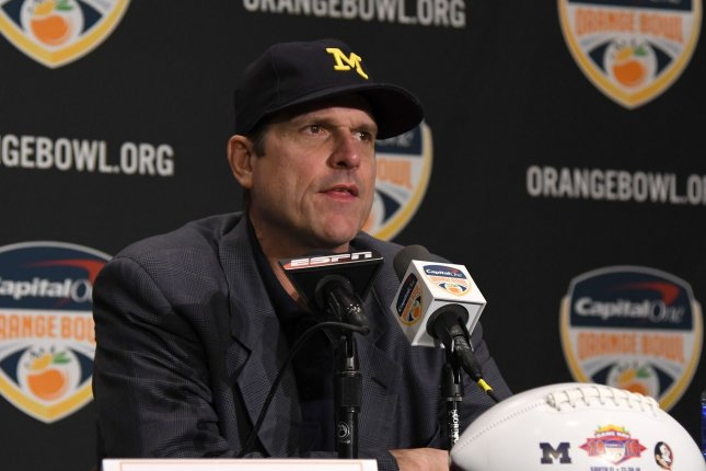 Michigan Wolverines head coach Jim Harbaugh answers questions from the media during the Orange Bowl head coaches press conference on December 29, 2016 at the Renaissance Fort Lauderdale Cruise Port hotel in Fort Lauderdale, Florida. File photo by Gary I Rothstein/UPI
