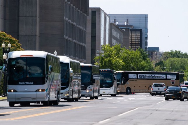 Buses circle on the National Mall as motorcoach operators rally for federal financial aid for their industry in the wake of the COVID-19 pandemic. Photo by Kevin Dietsch/UPI