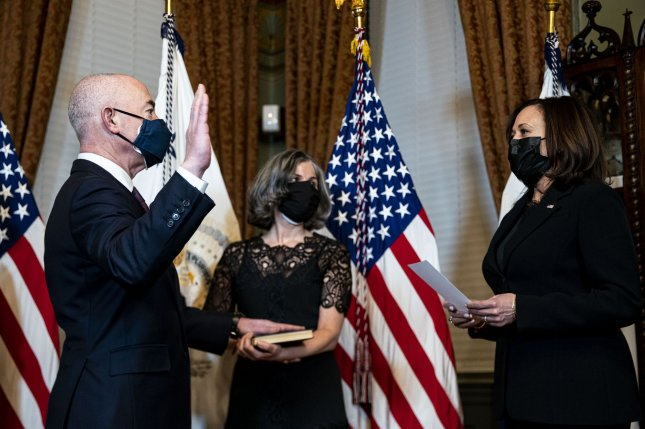 U.S. Vice President Kamala Harris (R) swears in Alejandro Mayorkas as the secretary of the Department of Homeland Security, as his wife, Tanya Mayorkas (C), holds a Union Prayer Book during a ceremony in Washington, D.C., on Tuesday. Photo by Al Drago/UPI