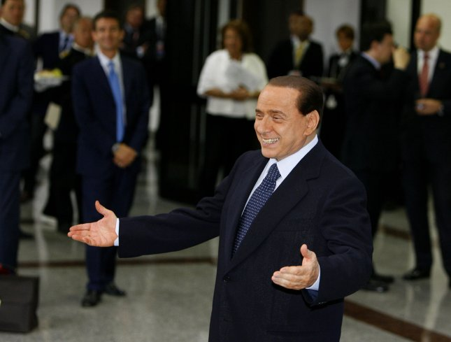 Italian Prime Minister Silvio Berlusconi greets G8 leaders as they arrive for a round table session at the G8 summit in L'Aquila, Italy on July 8, 2009. (UPI Photo/Stringer)