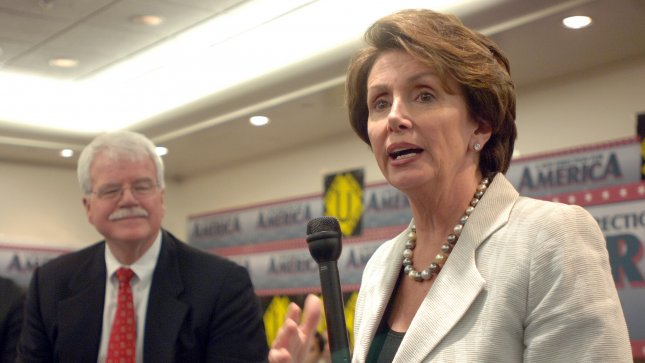 Rep. George Miller, D-Calif., (L) shown with House Minority Leader Nancy Pelosi, D-Calif. in 2006 file photo. Miller joins 100 House Democrats in introducing legislation to raise the federal minimum wage on July 27, 2012. (UPI Photo/Roger L. Wollenberg)