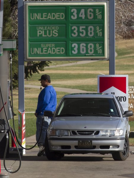 With his keys dangling, a driver watches the pump as his car is filled at a lower priced gas station in Denver on April 15, 2011. UPI/Gary C. Caskey