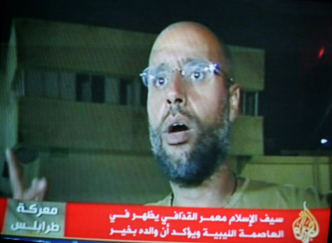 In an image taken from footage broadcast on Al-Jazeera television, Moammar Gadhafi's son Seif al-Islam appears at the Rixos hotel in Tripoli, Libya, Tuesday, August 23, 2011. Al-Islam, who was earlier reported arrested by Libya's rebels, appeared at the hotel and spoke to reporters early Tuesday. UPI