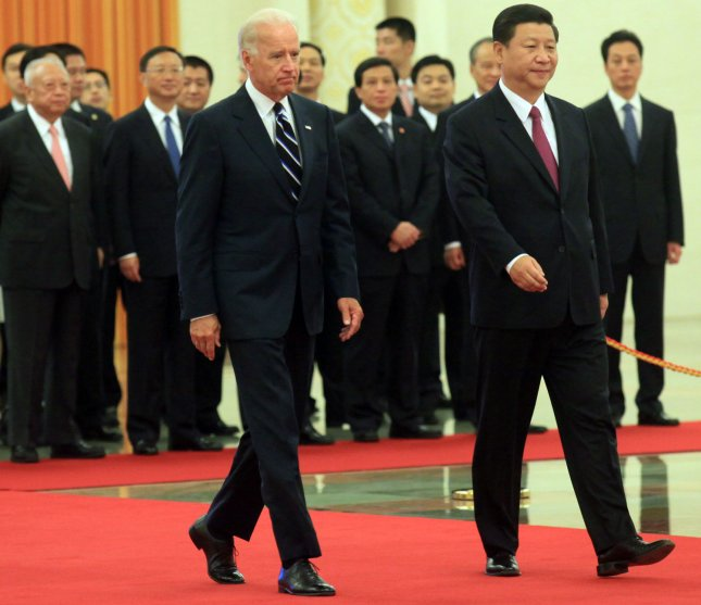 U.S. Vice President Joe Biden (L) is escorted by his Chinese counterpart Xi Jinping during a welcoming ceremony at the Great Hall of the People in Beijing on August 18, 2011. Global economic stability rests on the United States and China working together, Biden told China's president-in-waiting Xi, in talks seeking to shore up confidence in the dollar and bond with Beijing's next leader. UPI/Stephen Shaver