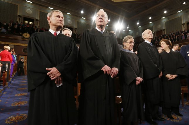U.S. Supreme Court Chief Justice John Roberts (L) stands with fellow Justices Anthony Kennedy (2nd from L), Ruth Bader Ginsburg, Stephen Breyer and Elena Kagan (R) prior to President Barack Obama's State of the Union speech on Capitol Hill in Washington, January 28, 2014. UPI/Larry Downing/Pool
