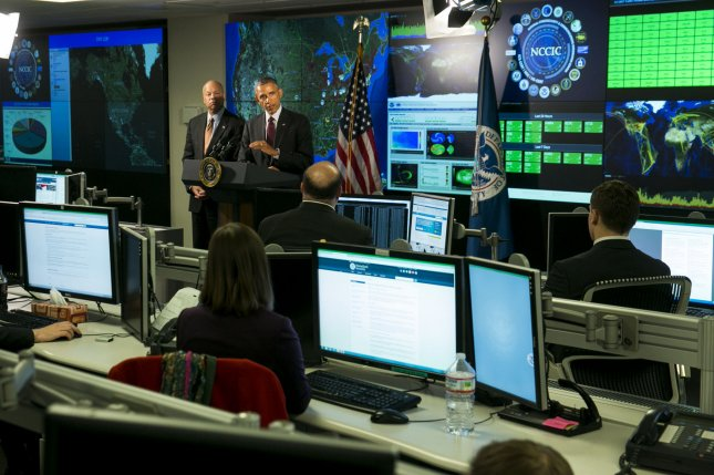 President Barack Obama delivers remarks at the National Cybersecurity and Communications Integration Center (NCCIC) in Arlington, Virginia on January 13, 2015. President Obama discussed efforts to improve the government's ability to collaborate with industry to combat cyber threats. Photo by Kristoffer Tripplaar/Pool/UPI