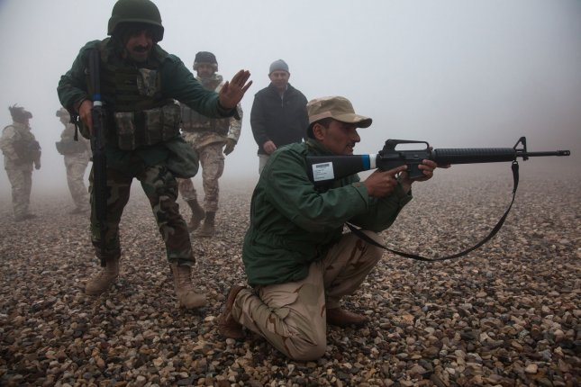 Kurdish Peshmerga soldiers conduct tactical movements during a live-fire exercise under the supervision and instruction of Italian soldiers near Erbil, Iraq, on March 28, 2016. Peshmerga military leaders said their troops were hit with cheminal weapons fired by Islamic State forces near the town of Gwer, Iraq, this week. Photo by Spc. Jessica Hurst/U.S. Army/UPI
