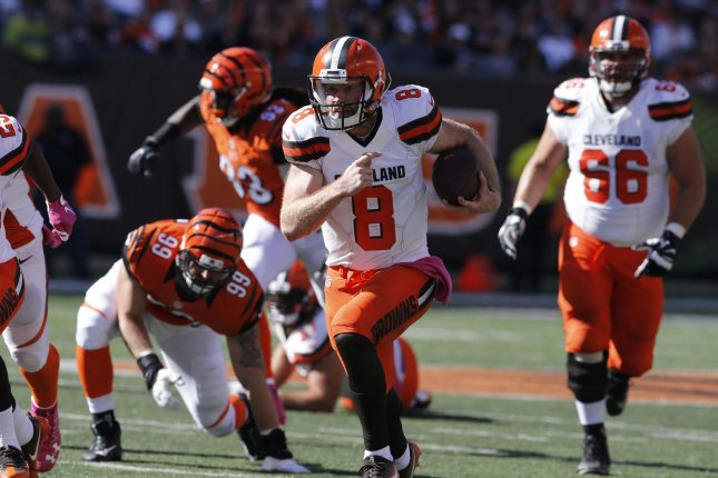 Cleveland Browns quarterback Kevin Hogan (8) runs for the touchdown against Cincinnati Bengals defense during the second half of play at Paul Brown Stadium in Cincinnati, Ohio, October 23, 2016. Photo by John Sommers II /UPI