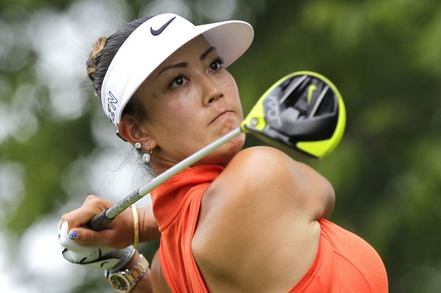 Michelle Wie hits her tee shot. Photo by John Angelillo/UPI
