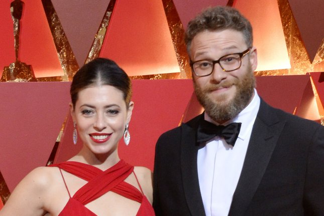 Seth Rogen (R) pictured with his wife Lauren Miller (L) has had his television adaptation The Boys ordered by Amazon. File Photo by Jim Ruymen/UPI