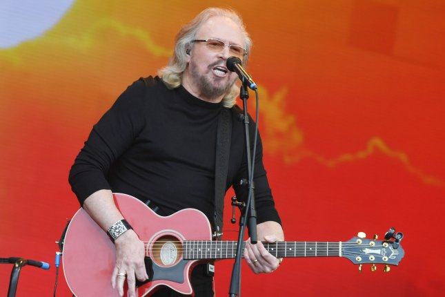 Bee Gees frontman Barry Gibb was knighted at Buckingham Palace. File Photo by Rune Hellestad/UPI