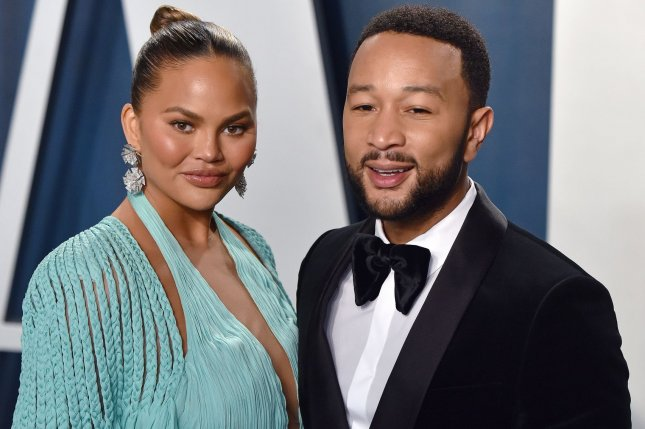 Chrissy Teigen (L) and John Legend arrive for the Vanity Fair Oscar party on February 9. Teigen announced on Instagram that she was in the hospital due to excessive bleeding. File Photo by Chris Chew/UPI