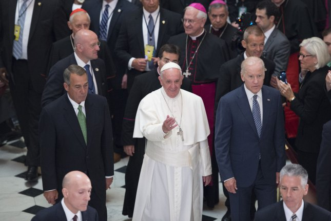 Then-Vice President Joe Biden walks with Pope Francis at the U.S. Capitol during a visit on September 24, 2015. File Photo by Michael Reynolds/UPI