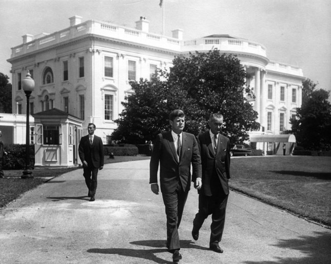 President John F. Kennedy (L) and Vice President Lynden Johnson walk by the South Lawn of the White House prior to the introduction ceremony for the Workmens' Compensation Commemorative Stamp in Washington on August 31, 1961. Photo by John F. Kennedy Presidential Library & Museum/UPI