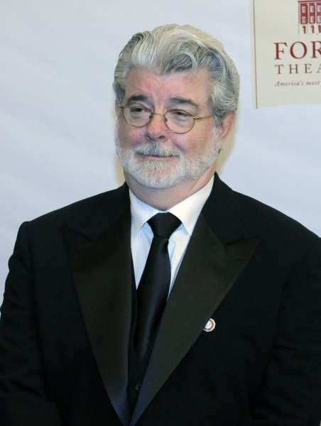 Filmmaker George Lucas arrives on the red carpet at the Ford's Theater official reopening celebration, marking the bicentennial of U.S. President Abraham Lincoln's birthday, in Washington on February 11, 2009. Lucas will be honored with a Lincoln Medal. (UPI Photo/Alexis C. Glenn)