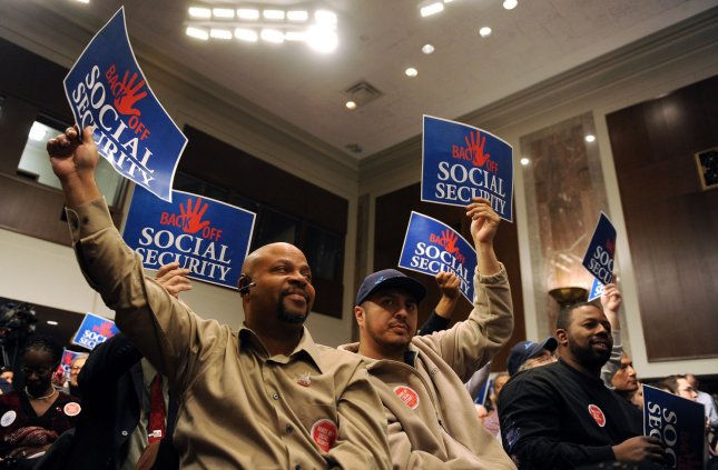 Participants hold signs reading BACK OFF SOCIAL SECURITY during an event in support of Social Security as it exists on Capitol Hill in Washington on March 28, 2011. UPI/Roger L. Wollenberg