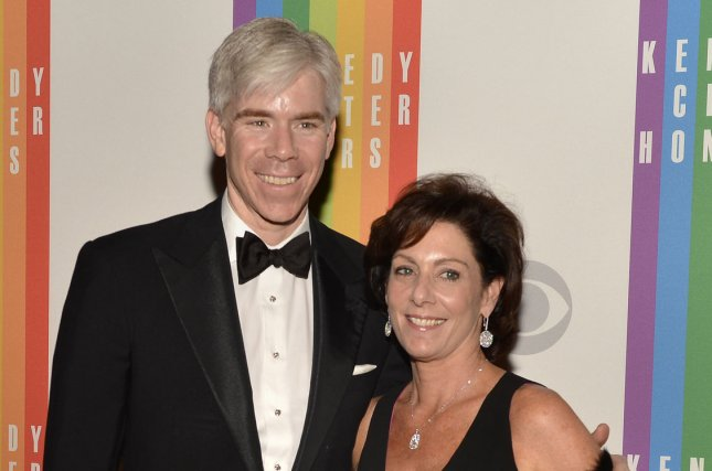 Police issued an arrest warrant for former NBC Meet the Press host David Gregory in 2013 after he showed a high-capacity gun magazine on the show. He was never arrested. Gregory and his wife Beth Wilkinson pose for photographers on the red carpet as they arrive for an evening of gala entertainment at the Kennedy Center in 2012, in Washington, DC. Photo by Mike Theiler/UPI