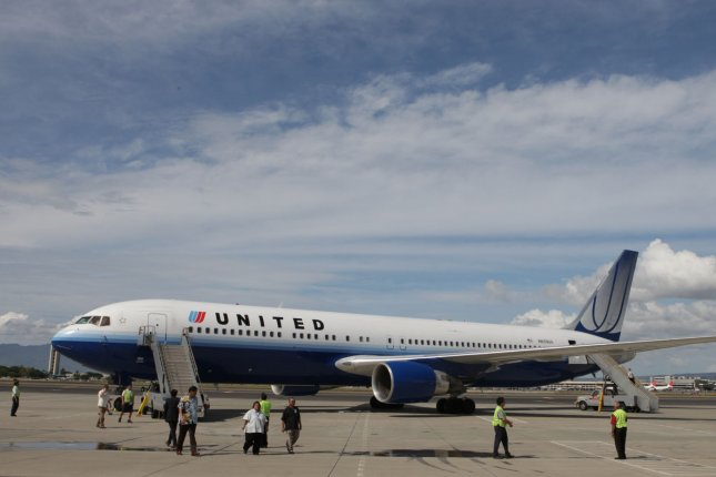 Online retail giant Amazon.com is reportedly in negotiations to lease nearly two dozen cargo planes to establish its own air freight operations. The company is considering converting Boeing 767 passenger jets, similar to the United Airlines 767 pictured, into cargo aircraft. File photo by Kent Nishimura/POOL/UPI