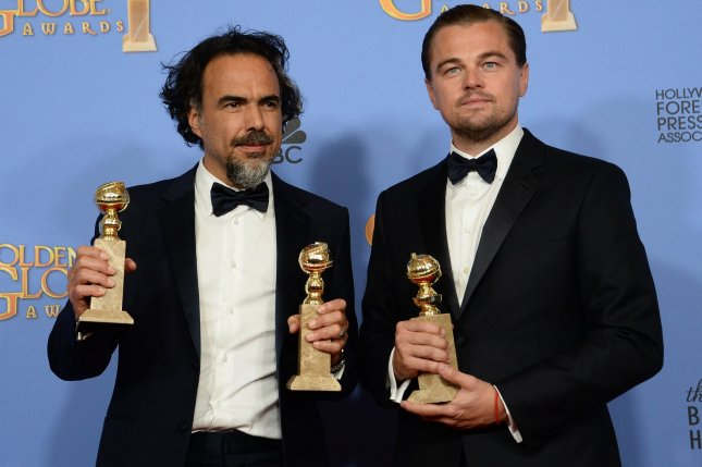 Writer/director Alejandro Gonzalez Inarritu, left, and actor Leonardo DiCaprio, winners of the award for Best Motion Picture Drama for The Revenant appear backstage during the 73rd annual Golden Globe Awards in Beverly Hills on January 10, 2016. Photo by Jim Ruymen/UPI