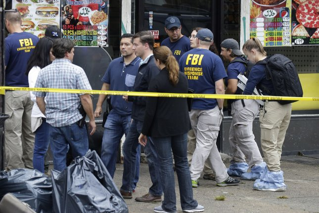 FBI investigators and police gather outside First American Fried Chicken after Ahmad Khan Rahimi, the man responsible for the New York and New Jersey bombings, was apprehended by police on September 19, 2016 in Elizabeth, New Jersey. Rahimi pleaded not guilty to charges connected with the shootout before his arrest, and still has not been served with federal charges for the bombings. File photo by John Angelillo/UPI