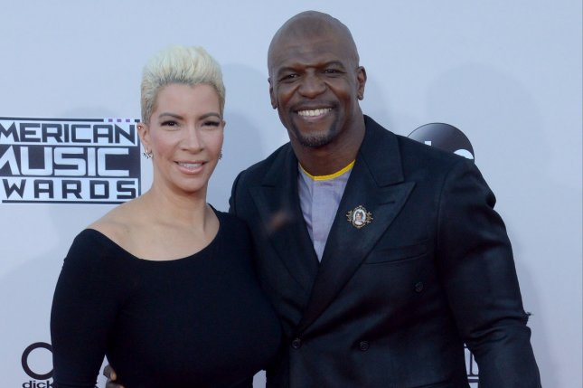 Terry Crews (R) pictured with his wife Rebecca King-Crews (L) has filed a police report against the man he says sexually assaulted him. File Photo by Jim Ruymen/UPI