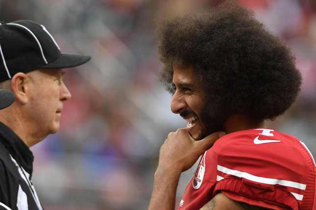 San Francisco 49ers QB Colin Kaepernick (R) jokes with an official in the third quarter against the New York Jets at Levi's Stadium in Santa Clara, California on December 11, 2016. File photo by Terry Schmitt/UPI