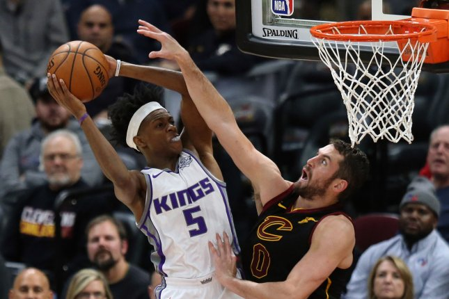 Sacramento Kings guard De'Aaron Fox (5) is fouled by Cleveland Cavaliers defender Kevin Love during the first half on December 6, 2017 at Quicken Loans Arena in Cleveland. File photo by Aaron Josefczyk/UPI