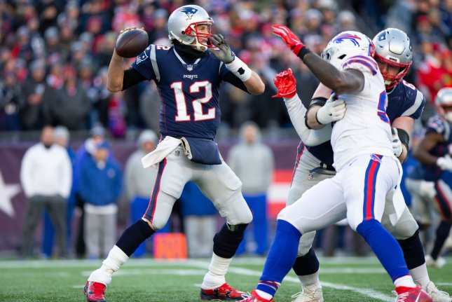 New England Patriots quarterback Tom Brady (12) drops back for a pass in the third quarter against the Buffalo Bills on Sunday at Gillette Stadium in Foxborough, Massachusetts. Photo by Matthew Healey/UPI