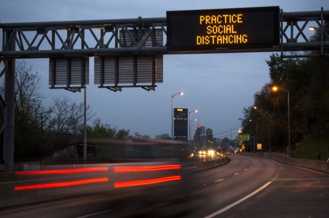 A traffic sign on Highway 28 in Pittsburgh, Pa., pictured Tuesday, recommends social distancing to stem the spread of the coronavirus disease. Photo by Archie Carpenter/UPI