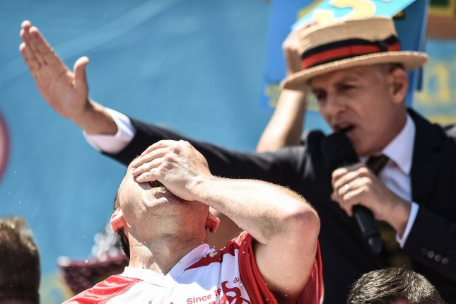Reining champion Joey Chestnut, shown competing at Nathan's Famous Fourth of July International Hot Dog Eating Contest last year, said he will miss the motivation of a live crowd this July Fourth. File photo by Steven Ferdman/UPI