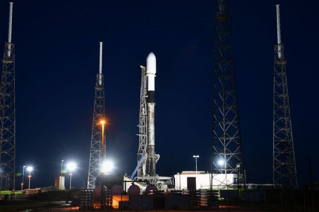 A SpaceX Falcon 9 rocket, similar to the one shown that was launched in 2020, is packed with dozens of satellites for the Transporter-1 rideshare launch Saturday. File Photo by Joe Marino/UPI