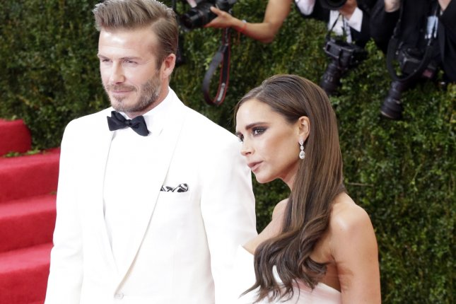 David and Victoria Beckham arrive on the red carpet at the Costume Institute Benefit celebrating the opening of Charles James: Beyond Fashion and the new Anna Wintour Costume Center at the Metropolitan Museum of Art in New York City on May 5, 2014. UPI/John Angelillo