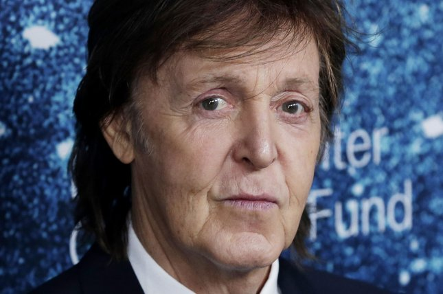 Paul McCartney arrives on the red carpet at the 2014 Women's Leadership Award Honoring Stella McCartney at Alice Tully Hall at Lincoln Center in New York City on November 13, 2014. In a recent interview with Britain's Esquire magazine, McCartney likened former band member John Lennon's death to martyrdom and explained how it affected his career. Photo by John Angelillo/UPI