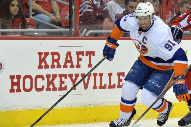 New York Islanders center John Tavares (91) skates for the puck. File photo by Kevin Dietsch/UPI