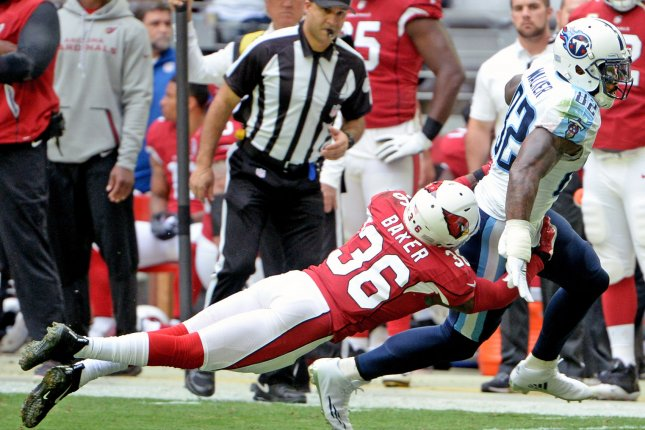 Tennessee Titans' Delanie Walker (R) is about to be tackled by Arizona Cardinals DB Budda Baker after a reception in the second quarter on December 10 at University of Phoenix Stadium in Glendale, Ariz. File Photo by Art Foxall/UPI