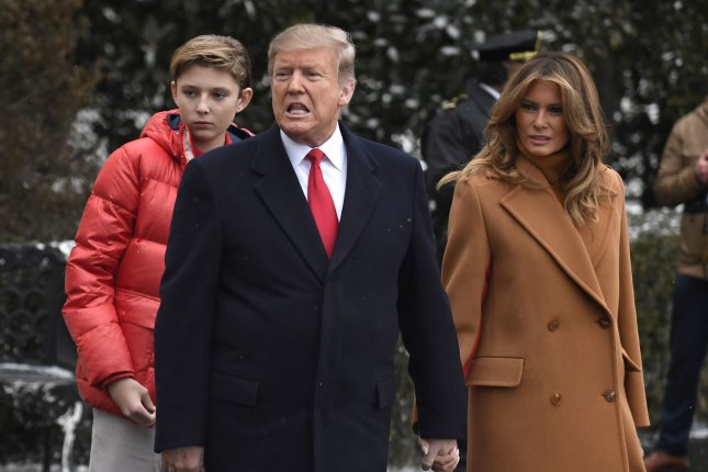 President Donald Trump, first lady Melania Trump and son Barron exit the White House Friday. Photo by Mike Theiler/UPI