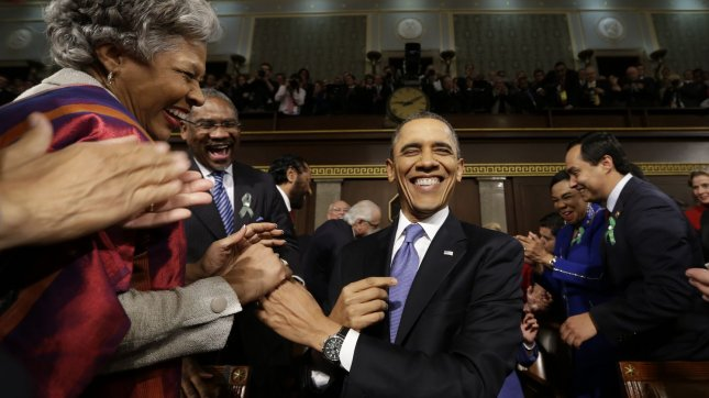 President Barack Obama is greeted before his State of the Union address during a joint session of Congress on Capitol Hill in Washington, DC on February 12, 2103. UPI/Charles Dharapak/Pool