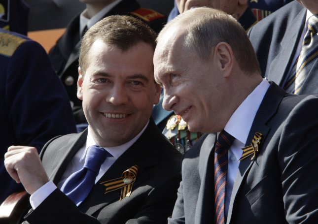 Russian President Dmitry Medvedev (L) and Prime Minister Vladimir Putin chat during the Victory Day military parade in Red Square in Moscow on May 9, 2009. Today Russia celebrates the 64th anniversary of the World War Two victory over Nazi Germany. (UPI Photo/Anatoli Zhdanov)