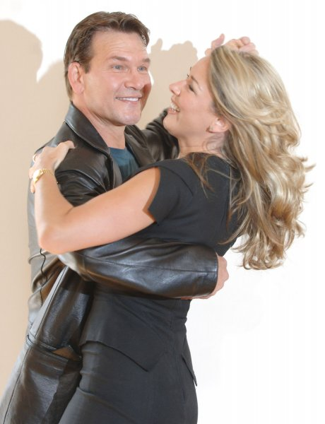 American actor Patrick Swayze and British actress Claire Sweeney attend a photocall for the musical Guys and Dolls at The Century,Piccadilly in London on June 5,2006. (UPI Photo/Rune Hellestad)